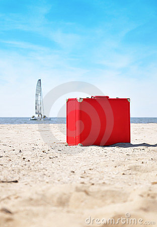 Red Travel Vacation Suitcase on Beach