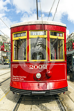 Red trolley streetcar on rail