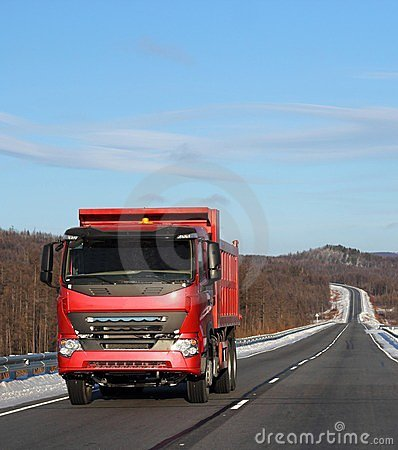 red truck on a winter road.