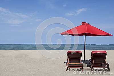 Red umbrella and two chairs