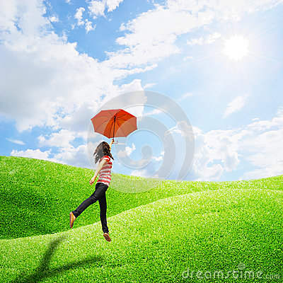 Red umbrella woman in grassland and sun sky