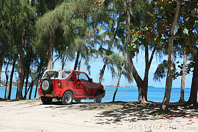 Red vehicle on the beach