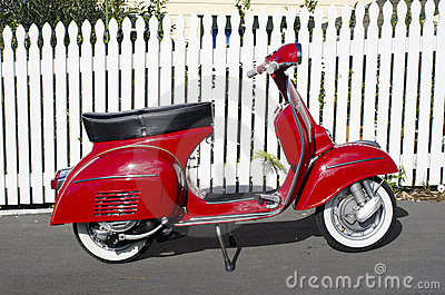 Red Vespa motor scooter Editorial Stock Image