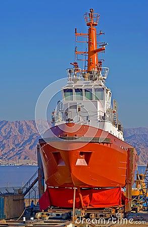 Red vessel in dock