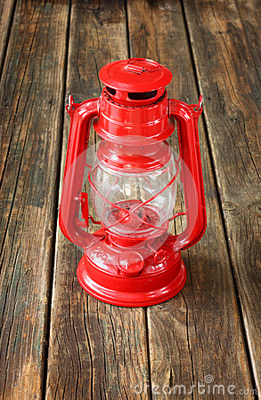 Free Red Vintage Lamp On Wooden Table. Copy Space. Stock Photography - 35662482