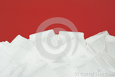 Red wall painted in white with paint roller