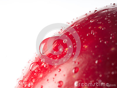 Red wet apple with big droplet, macro shot