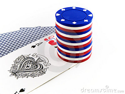 Red White and Blue Poker Chips on Playing Cards