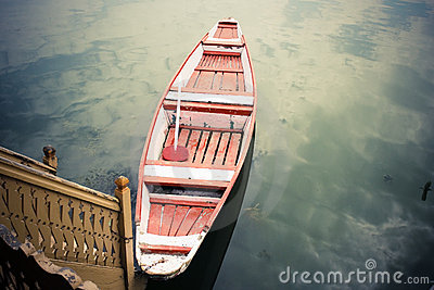 Red and white boat on lake.