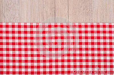 Red and white checkered cloth on wood