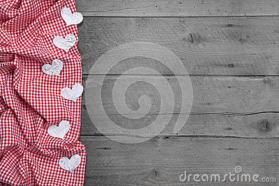 Red and white checkered frame with hearts on woode
