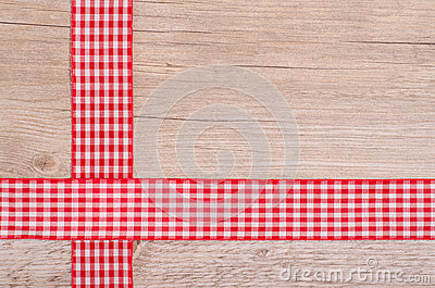 Red and white checkered ribbons on wood