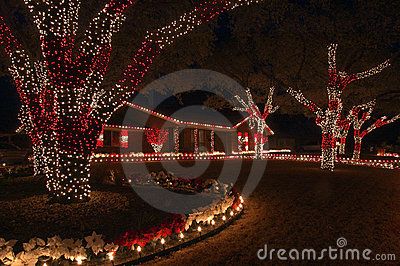 Red and white holiday lights is the color theme for this home and yard oB8TNf1E