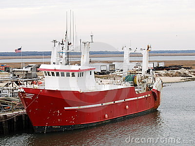 Red & white commercial fishing boat
