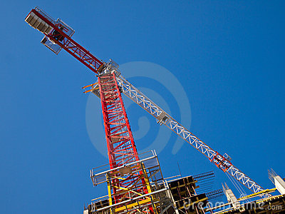 Red and white crane gibbet on blue sky