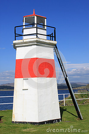 Red and white lighthouse at NW end of Crinan canal