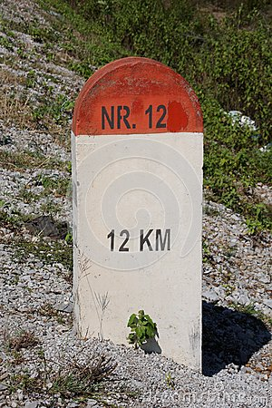 Red and white milestone