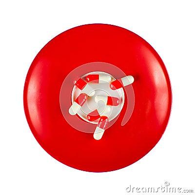 Red-white pills on dish