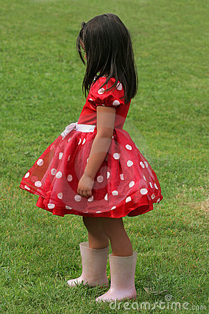 White Polka  Dress on Little Girl In A Red And White Polka Dot Dress Wearing Pink Wellington