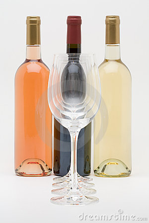 Red white and rose wine bottles with glasses