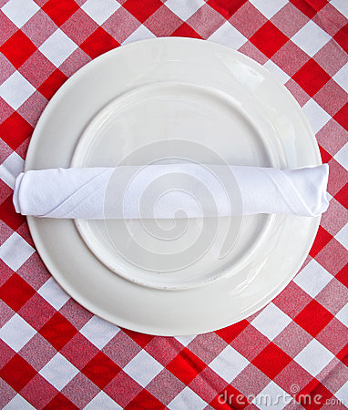 Red and white table cloth with plate