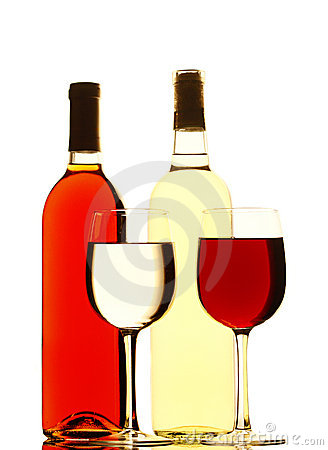 Red and White Wine Bottles and Filled Glasses