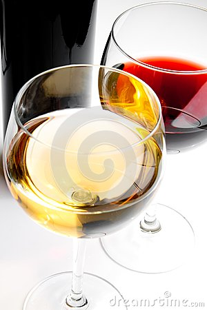 Red and white wine glasses with black bottle