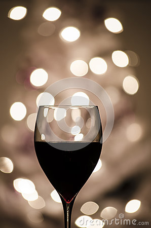 Red wine against blurred lights