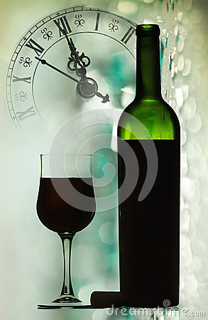 Red wine against holiday lights and clock