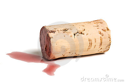 Red wine cork lying in a puddle