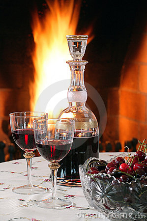 Red wine at the fireplace