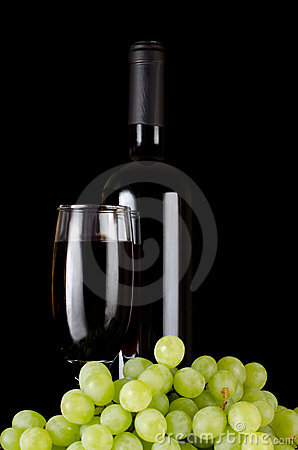 Red wine glass on a black