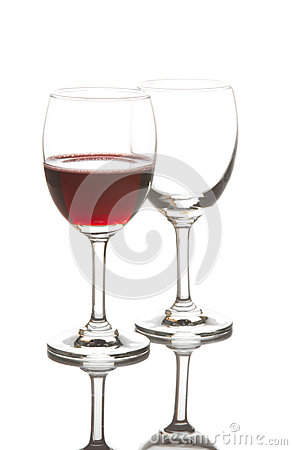 Red wine glass and empty wine glass