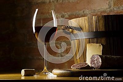 Red wine glass in rural kitchen