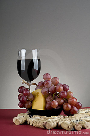 Red wine glass witn cheese and grape.