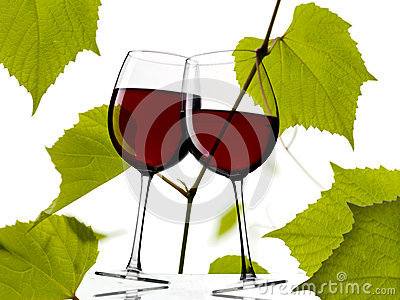 Red wine with grapes leaves