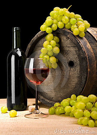 Red wine and green grape and barrel