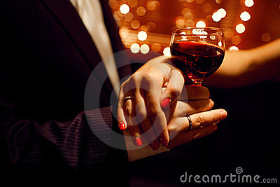 Red wine and hands of lovers