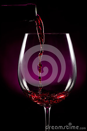 Red wine pouring on black