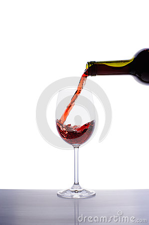 Red wine pouring into wine glass