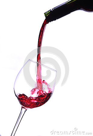 Red wine pours into a wineglass