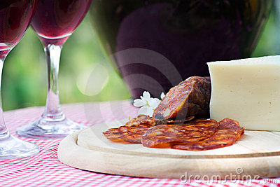 Red wine and sausage with cheese