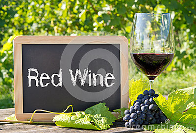 Red wine sign with grapes