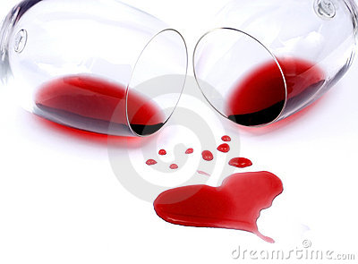 Red wine spilled on white background