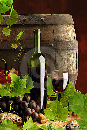 Red wine with vine and cask