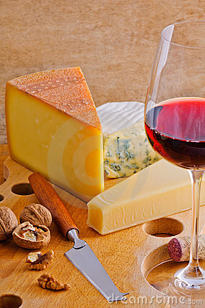 Red wineglass and cheese plate