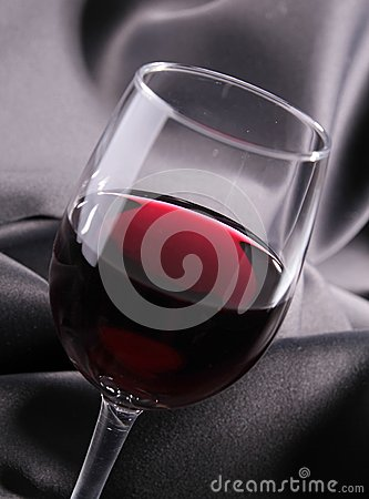 Red wineglass on silk