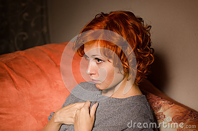 Red woman on a sofa