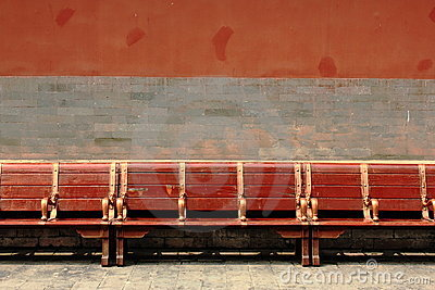 Red wooden bench in the Forbidden City, Beijing