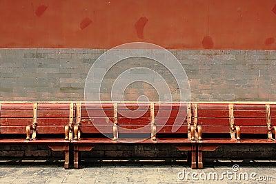 Red wooden bench in the Forbidden City, Beijing
